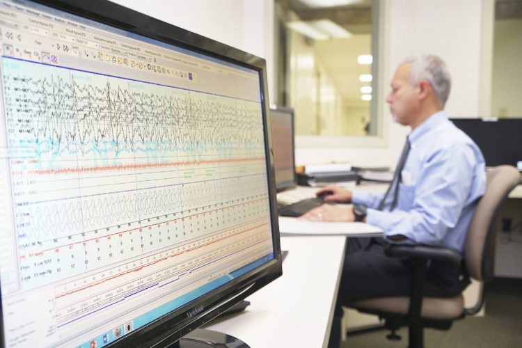 Submitted Photo Pictured, Medical Director UPMC Chautauqua WCA Sleep Center, Frank Arnal, MD, FCCP, board-certified in internal medicine with sub-specialties in pulmonology, sleep medicine and critical care, and a physician member of Great Lakes Physician Practice, JAMA-GLPP, reviews a sleep study. UPMC Chautauqua WCA recently installed new, powerful Natus technology that enhances sleep outcomes.