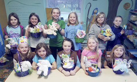 Submitted Photo Chautauqua County Girl Scouts from Brownie Troop 20096 and Juniors of Troop 20096 working on their Bronze Award purchased items to make Easter Baskets for children in their community. The girls assembled over 30 baskets with candy, puzzles, stuffed animals, a chocolate bunny and other Easter-themed items for the local BackPack program at Chautauqua Literary & Scientific Circle.