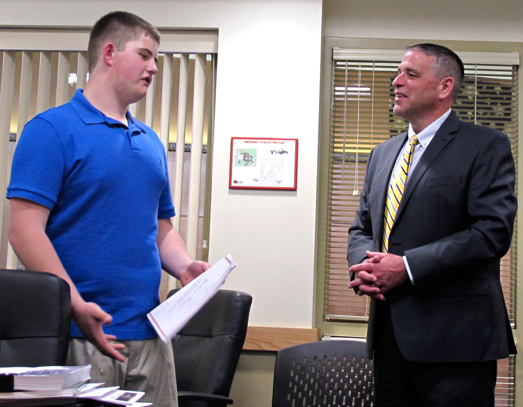 OBSERVER Photo by Rebecca Cuthbert. Superintendent Todd Crandall looks on as Silver Creek Central student Gabriel Metzger explains how he won the American Institute for Aeronautics & Astronautics essay contest, with helpful nudging from Cheryl Smith, his science teacher, who knew Metzger could do it.