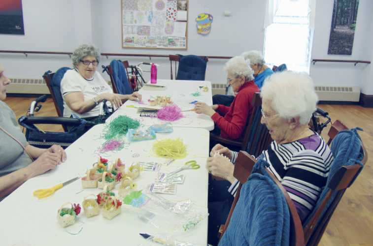 Submitted Photo: Once again the ladies of the WCA Home in Fredonia opened their hearts to put a smile on others' faces. The ladies made Easter basket favors for the trays of patients who were at Brooks Memorial Hospital on Easter Sunday.