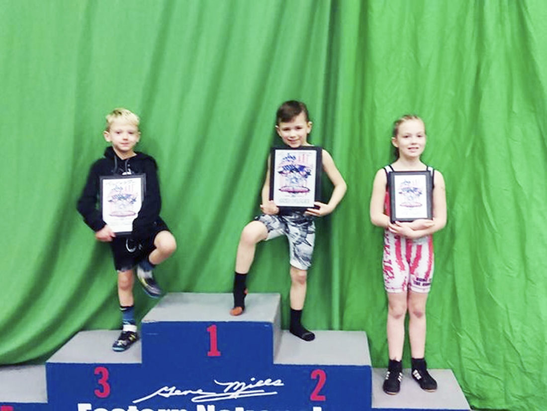 Submitted Photo: On Saturday, April 8, three Grindhouse youth wrestlers participated in the Gene Mills Eastern National Tournament held in Syracuse. Pictured, from left, are Tanner Stern, who placed 3rd in the 40lb division; Xavier Thuman, who finished 2nd in the 55lb division and Alexiya Thuman, who placed 4th in the girls 65lb division.