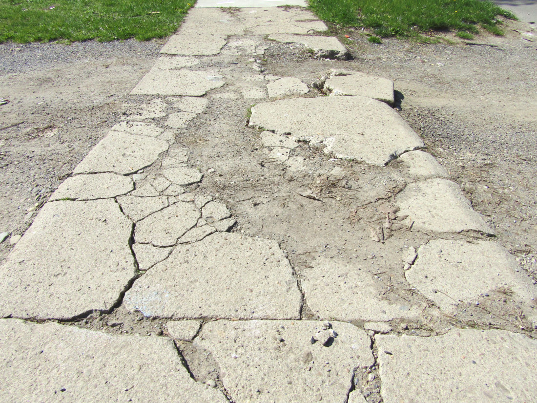 OBSERVER Photo by Greg Fox: The sidewalks in Silver Creek are considered to be severely lacking, and relatively dangerous. The village hopes that with some impending grant funds, the situation in a number of heavily-trafficked areas could be remedied.