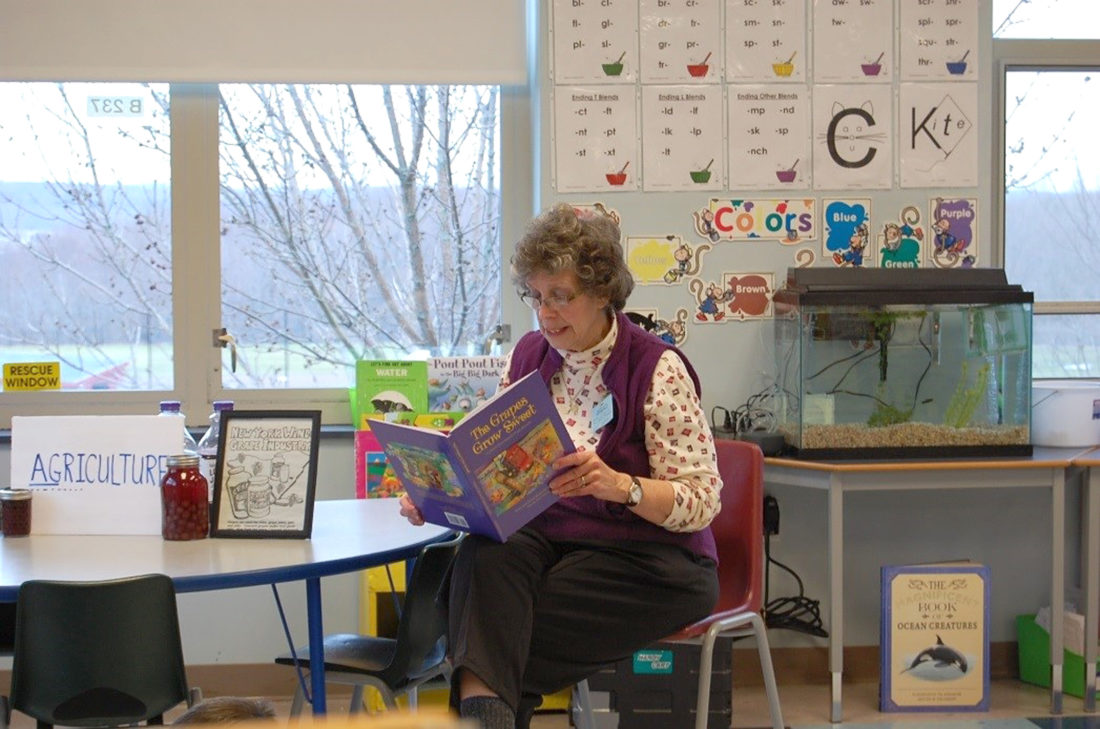 "Submitted Photo: Ag Literacy Week Volunteer, Sue Harper, read ""The Grapes Grow Sweet"" to students at Chautauqua Lake."