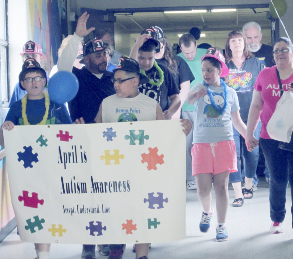 OBSERVER Photo by Damian Sebouhian Students, teachers, and parents parade through the BOCES LoGuidice Center building celebrating Autism awareness.