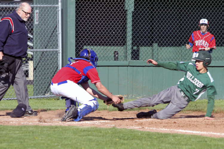 OBSERVER Photo by Lisa Monacelli Cassadaga Valley catcher Jacob Peterson tags out Brocton baserunner Derrick Burns on a throw from Brandon Chamberlain Wednesday in Brocton.