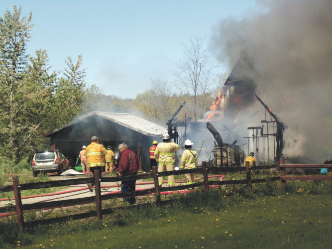Photo by Jimmy McCarthy Multiple fire agencies battled a blaze at a 2092 28th Creek Road residence in Gerry on Tuesday. According to scanner reports, the fire started as a chimney fire. A resident in the home was able to get out safely.
