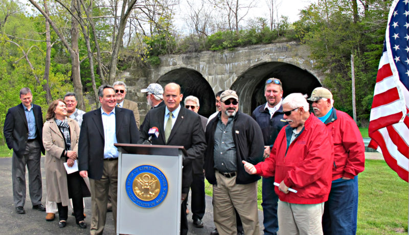OBSERVERPhoto by Rebecca Cuthbert Congressman Tom Reed stopped in the village of Silver Creek Tuesday to discuss the importance of the Great Lakes Restoration Initiative with constituents. Reed, standing behind the podium, is pictured here with Westfield Town Supervisor Martha Bills and County Executive hopeful George Borrello (left), residents, outdoorsmen and other officials.