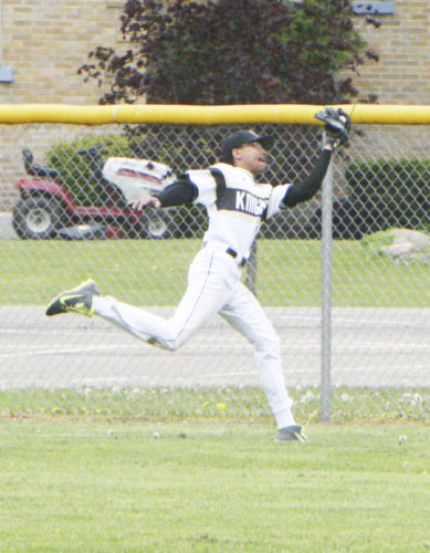 Photo by Matt Spielman: Silver Creek/Forestville center fielder Austin Myers makes a lunging catch just in front of the fence during the third inning of Thursday's CCAA West 1 baseball game against Maple Grove in Bemus Point.