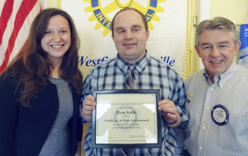 "Submitted Photo On May 2, Ryan Kalie (center), MNE Oasis Program student, received a ""Certificate of High Achievement"" recognition by Daniel Smith (right), Rotary Club of Westfield-Mayville Youth Services Chair. MNE Oasis Program Director Katie Huba (left), Rotarians and guests were present to congratulate Kalie."