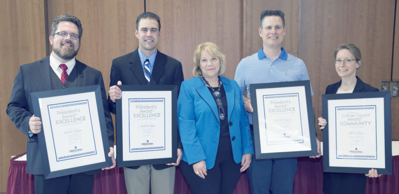 Submitted Photo Honorees at the President's Recognition Luncheon, displaying their framed award certificates with Fredonia President Virginia Horvath (center) are (from left): Dr. Rob Deemer, Mark Suida, Dr. Scott Ferguson and Dr. Jill Reese. Pictured below is Ann Carden.