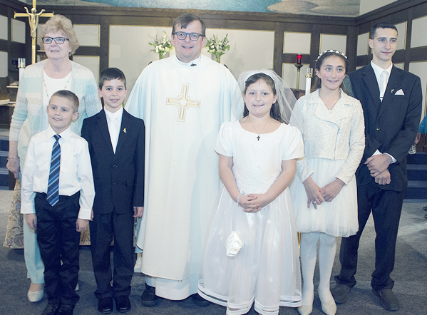 Submitted Photo: The Sacrament of First Holy Communion was celebrated by students and their families on May 6 at Our Lady of Mt. Carmel Roman Catholic Church in Silver Creek. Pictured: Deanna Borrello, catechist; John Schlenker III, Samuel Bowers, the Rev. Dan Fiebelkorn, pastor; Cassidy Westbrook, Madison Sliwinski and Garrett Sliwinski.