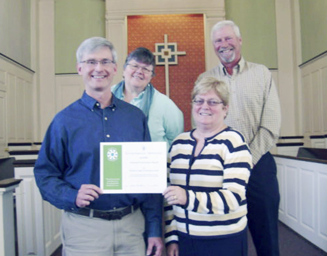 Submitted Photo: Fredonia Presbyterian Church has been certified as an Earth Care Congregation by the Presbyterian Church U.S.A. for a third year. This certification results from consistent efforts to honor and preserve the environment through dedicated worship services, education programs, green choices in building maintenance, and public advocacy. Pictured are: Jeff McMinn (Trustee President); Sandy Johnson (Elder); and Betsy and Tom White who manage the Giving Garden which provides vegetables to the Rural Ministry of Northern Chautauqua County.