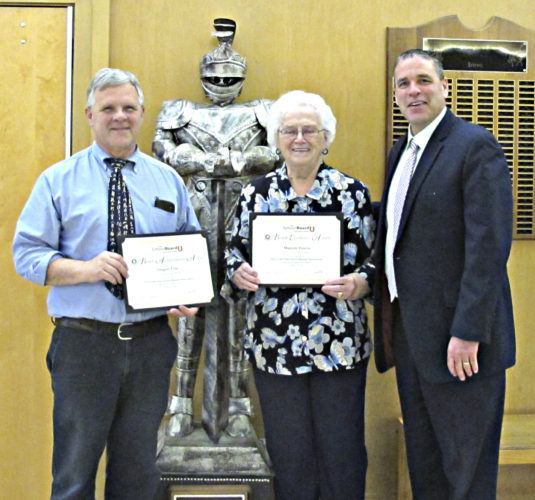 OBSERVER Photo by Rebecca Cuthbert: Pictured, from left, is Silver Creek Central School Board of Education President Greg Cole, board member Marge Foxton and Superintendent Todd Crandall, posing with the famous Black Knight. Both Cole and Foxton were honored with Board Achievement Awards, presented to them by Crandall. Cole and Foxton have been serving the Silver Creek Central School District and its students for many years — and, for Foxton, it has been a lifelong endeavor that she's not finished with yet. She is re-running for her seat on the school board, unopposed. The vote takes place Tuesday, along with the budget vote, in the high school lobby from 1 to 9 p.m.