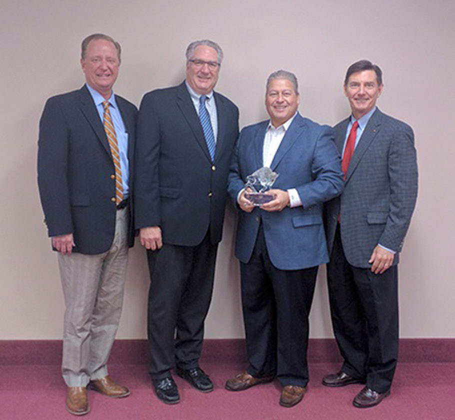Submitted Photo Pictured from left: Charlie Makey, Senior Vice President, Insurance Operations, Merchants Insurance Group; Greg Robinson, Regional Vice President, Merchants Insurance Group; Wally Gotowka, Partner, Lawley-Tradition LLC; and Robert M. Zak, Merchants' president and CEO.