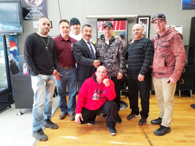 "OBSERVER Photo by Jared Hill Pictured in front is ""Pitbull"" Jose Hernandez. In middle from left, are professional boxer Ivan Hernandez, Coucilman Marty Bamonta, Mayor Willie Rosas, Elon DeJesus, Councilman Andy Gonzalez and Elon's father, Nicky DeJesus. In the back is Impact Boxing trainer Nate Jimerson."