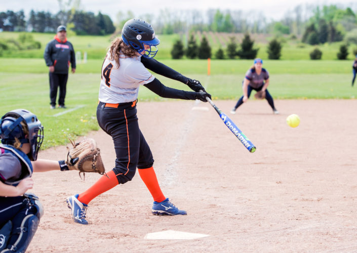 OBSERVER Photo by Ron Szot Fredonia's Caitlyn Cybart drives a ball during Fredonia's CCAA West 1 softball matchup against the Chautauqua Lake Lady Thunderbirds Thursday in Fredonia.