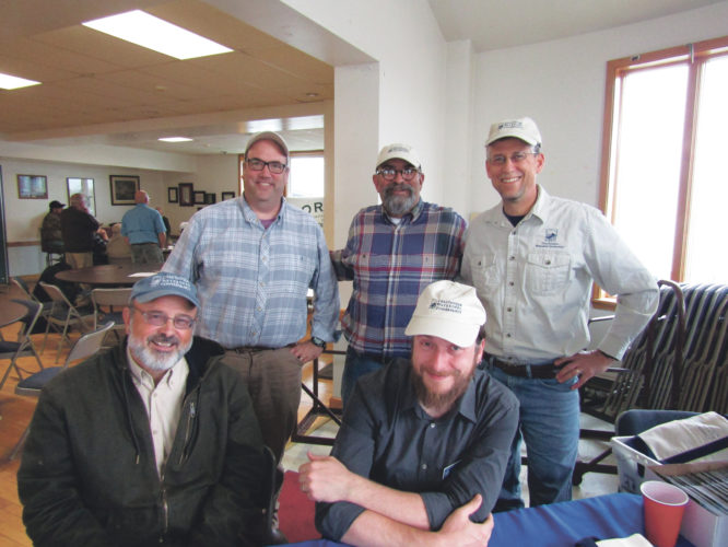 OBSERVER Photo by Gene Pauszek Chautauqua Watershed Conservancy members at the April 29 event were, seated from left, David Anderson and Jonathan Townsend. Standing are Mike Jabot, Alberto Rey and John Jablonski III.