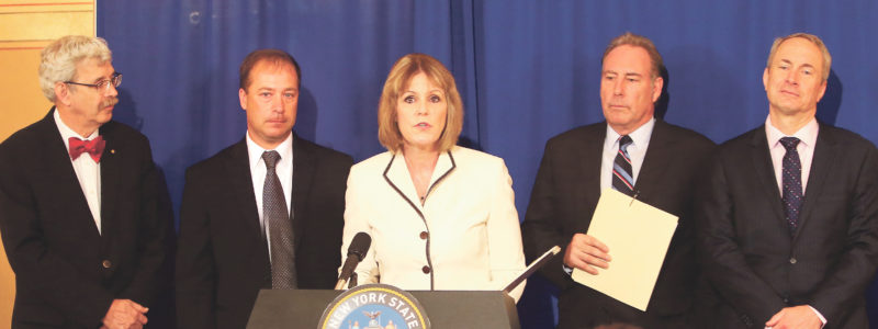 "Submitted Photo During a press conference at the Capitol, Senator Catharine Young (center), joined by national highway safety advocate Stephen Eimers (center-left), Senator Joseph Robach (center-right), Assemblyman Sean Ryan (far-right) and Assemblyman Andy Goodell (far-left), called for passage of legislation to ban and remove dangerous ""X-Lite"" guardrails from roadways across New York."