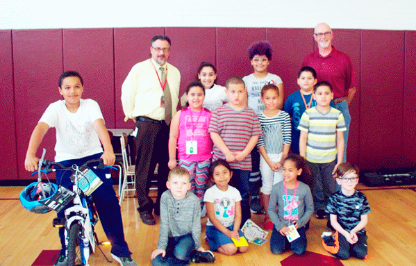 Submitted Photo Pictured are School 3 recipients of bicycles under the Bikes-4-Books program. To left on bike: Kyle Augustin. Front row from left: Kayden Schunk, Eliza Bautista, Shaniya Watts and Miles Piche. Second row:  Jillesy Rivera, Ryan Falco, Jasiret Orsini and Yeriel Gutierrez. Third row: Building Administrator Daniel Genovese, Chassity Mercado-Genera, Kaydance Campbell, Xavier Vasquez, John Bogardus.