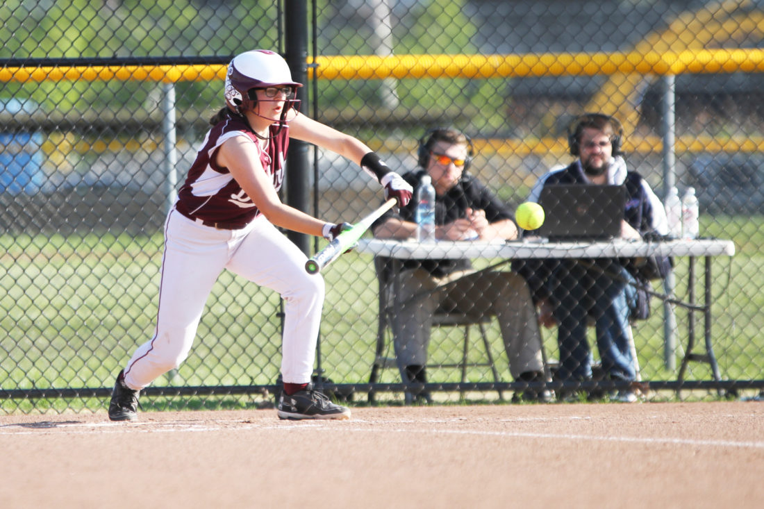 OBSERVER Photo by Mary Ann Wiberg Above, Dunkirk's Emma Newton lays down a bunt during the No. 10 Lady Marauders' playoff game against No. 7 CSAT on Tuesday in Dunkirk.