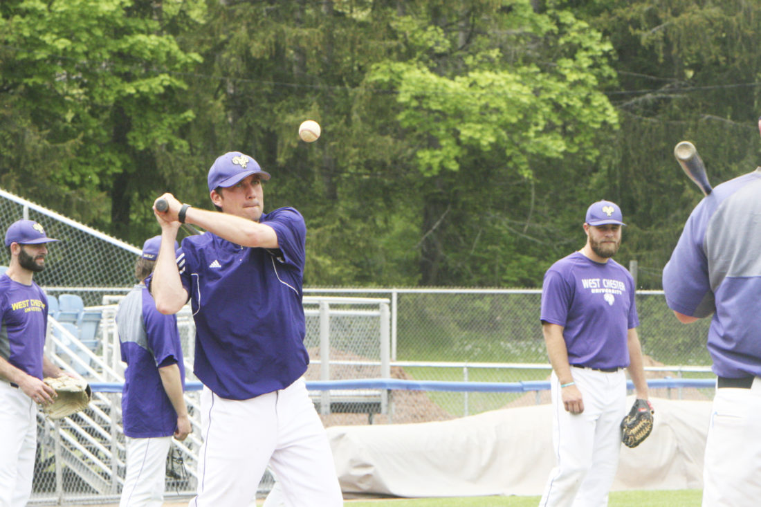 Photo by Scott Kindberg Pictured hitting a fungo is West Chester coach Jad Prachniak during Wednesday's practice at Diethrick Park for the NCAA Division II Atlantic Region Championships.
