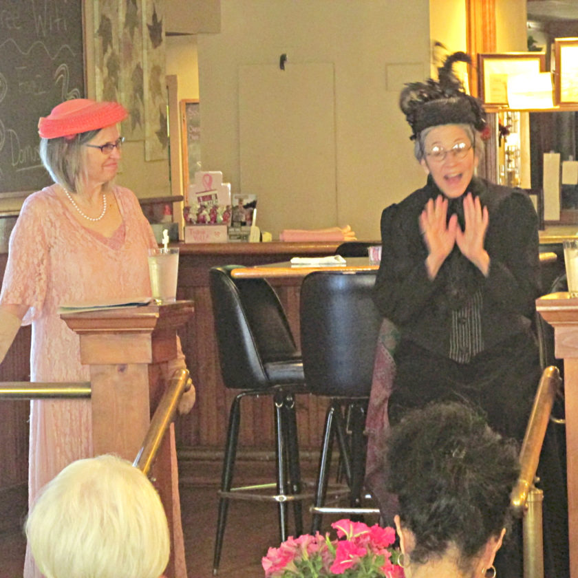 OBSERVER Photo by Damian Sebouhian. Right: Susan B. Anthony (Christina Rausa) answers questions about her role in the suffrage movement.