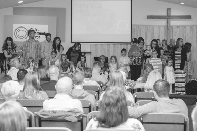 Submitted Photo: The congregation of Christ Community Church watches with anticipation as children gather for dedication.