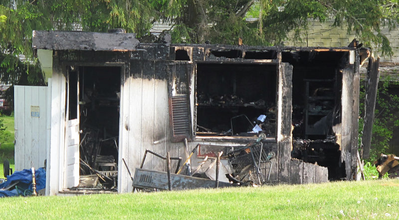 OBSERVER Photo by Rebecca Cuthbert: An outbuilding at 92 W. Chestnut St. in the city of Dunkirk was heavily damaged in a fire Friday morning. Dunkirk Fire Chief Michael Edwards reported his department responded to the call at about 6:45 a.m. Upon arrival, crews found the detached shed heavily involved in fire. The blaze was quickly extinguished and there were no injuries. The fire department was on scene for one hour. The cause of the fire was determined to be an electrical overheat.