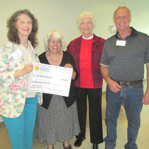 Lily Dale Assembly members stand with their $10,000 check to help fund a butterfly habitat.