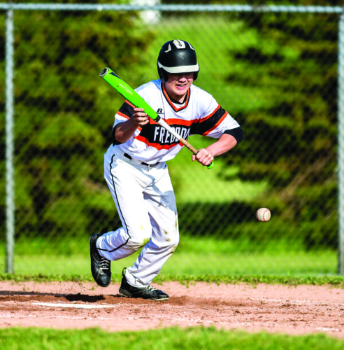 OBSERVER Photo by Ron Szot: Fredonia's Tyler Winchell sprints down the first-base line after bunting during Friday's Section VI Class B-2 high school baseball quarterfinal game against Wilson.