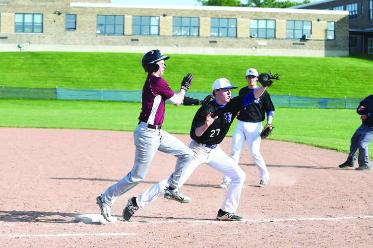 OBSERVER Photo by Roger Coda: Westfield pitcher Eric Fermier (27) covers first base ahead of a Portville baserunner during Friday's Section VI Class C-2 high school quarterfinal playoff game.