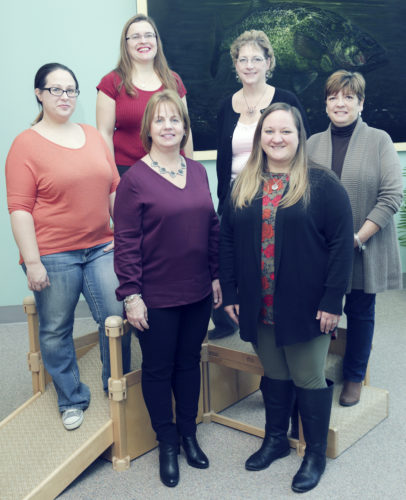 Submitted Photo Campus and Community Children's Center staff including (front, left to right) Beth Mulkin, executive director, joined by Tammi Sullivan, school age coordinator; and (back, left to right) Jennifer Branden, administrative assistant; Teodora Cox, board president; Michele Frederickson, food service coordinator; and Joyce Jabot, finance coordinator.