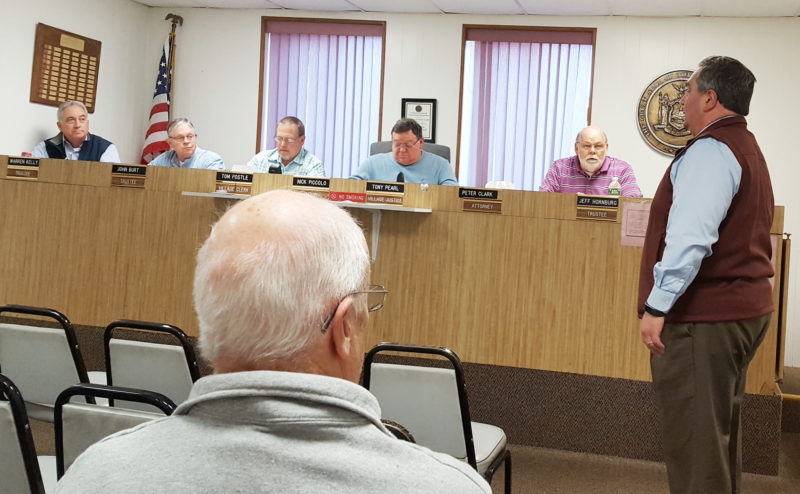 OBSERVER Photo by Nicole Gugino County Legislator George Borrello (right) speaks to the Silver Creek Village Board about the resolution of support to participate in the county's phase two Municipal Consolidation and Efficiency Competition application.