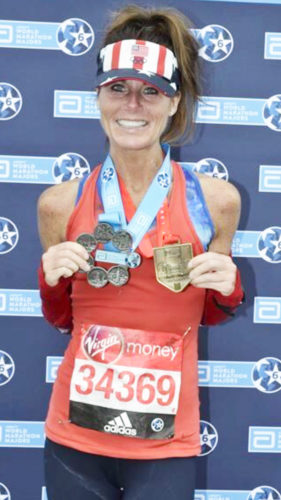 Submitted Photo Pine Valley teacher Jen Giebner shows off the medals she recently earned in London, England after completing the final leg of the World Marathons.