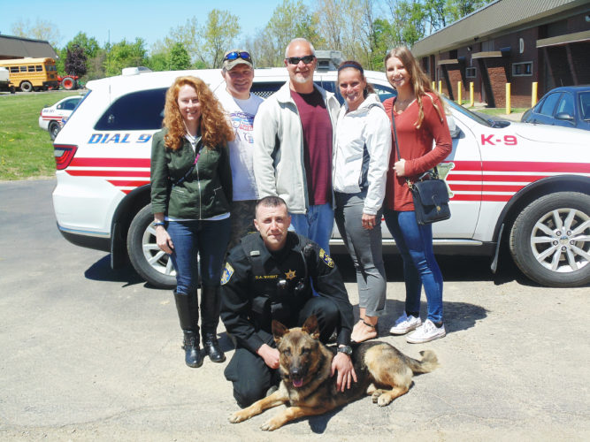 Photo by Jimmy McCarthy The family of Chautauqua County Sheriff's Deputy Kevin Link had the chance to see for the first time K-9 Link and Sheriff K-9 Handler Chad Wright. Pictured from the left are: Kelly Link, Kevin's wife; Robert Link, brother; Doug Owen, brother-in-law; Maggie Owen, sister; Miranda Owen, niece; K-9 Link and Wright. Not pictured is Rena Fox-Link, sister-in-law, who was also in attendance.