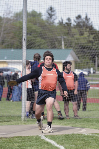 OBSERVER Photo by Roger Coda Fredonia's Nate Shuart launches a discus during Monday's track and field event at Fredonia Central School.