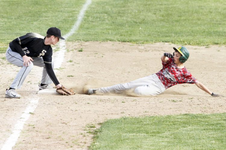 OBSERVER Photo by Lisa Monacelli Silver Creek's Dylan Slaght tags out a Maritime runner attempting to steal during Section VI Class C1 baseball action on Monday.