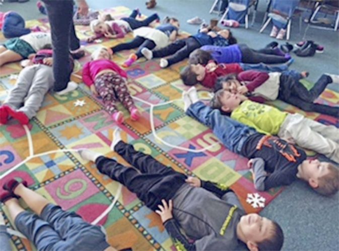 Submitted Photo Pictured are students putting what they have learned about yoga into practice in Erin Wodzinski's class at A. J. Schmidt Elementary.