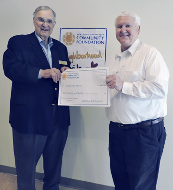 Submitted Photo Shown in the photograph receiving the check for the Sinclairville 76ers meals on wheels program for the purchase of a new van: NCCF representative Jim Holton (left) presents a $5,000 check to the 76ers vice president John Sipos.