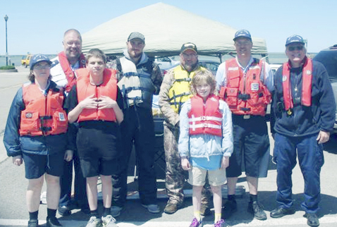 "Submitted Photo: Members of the Dunkirk U.S. Coast Guard Auxiliary Flotilla 34 held a ""Ready Set Wear It!"" event Saturday, May 20 on the Dunkirk city pier. Members of the public were invited to put on a PFD (personal flotation device) to have their photo taken and registered their name to help break the world record. The event was held to kick off the National Safe Boating Week."