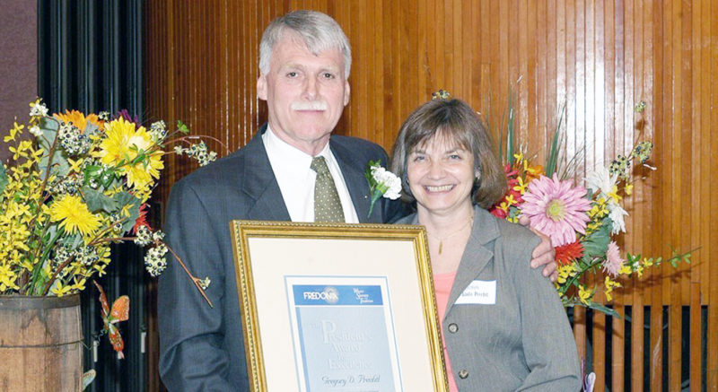 Submitted Photo: Greg Prechtl and his wife Linda after he received in Fredonia President's Award for Excellence in 2006.