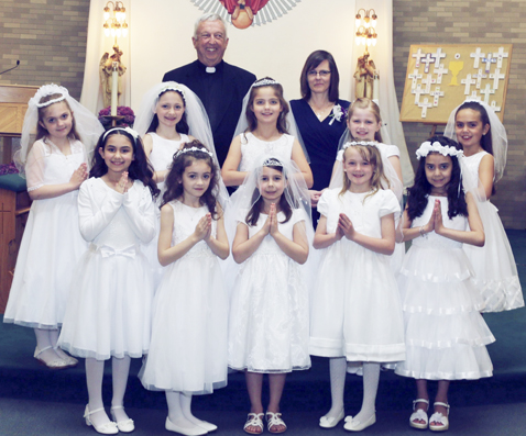 Submitted Photos The Sacrament of First Holy Communion was celebrated by children and their families of Holy Trinity Roman Catholic Parish in Dunkirk on Sunday, May 14 during the 11 a.m. Mass with Fr. Daniel Walsh, pastor. Pictured above from left are: First row: Molly Tuccio, Laci Delcamp, Elizabeth Joy, Carilene Sliwa and Gianna Corsi. Second row: Emma VanValkenburg, Katherine Fortna, Lila Drab, Allison Hellwig and Adriana Kubacki. Third row: Fr. Daniel P. Walsh, pastor and Denise Joy, catechist.