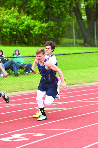 OBSERVERPhoto by Roger Coda: Chautauqua Lake's J.C.McCroskey hands the baton to teammate Evan Blakeslee in the 4x100-meter relay at Friday's County meet at Karl Hoeppner Field.