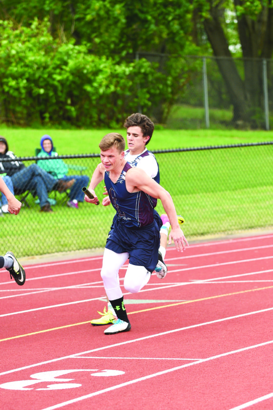 OBSERVER Photo by Roger Coda: Chautauqua Lake's J.C. McCroskey hands the baton to teammate Evan Blakeslee in the 4x100-meter relay at Friday's County meet at Karl Hoeppner Field.