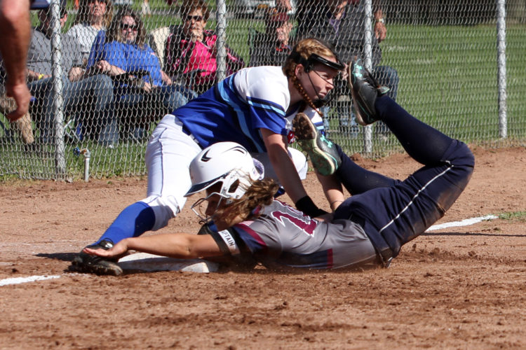 OBSERVER Photo by Lisa Monacelli Cassadaga Valley third baseman Brittyn LeBaron tags Chautauqua Lake baserunner Cameryn Hawkins after Hawkins was caught in a run down.