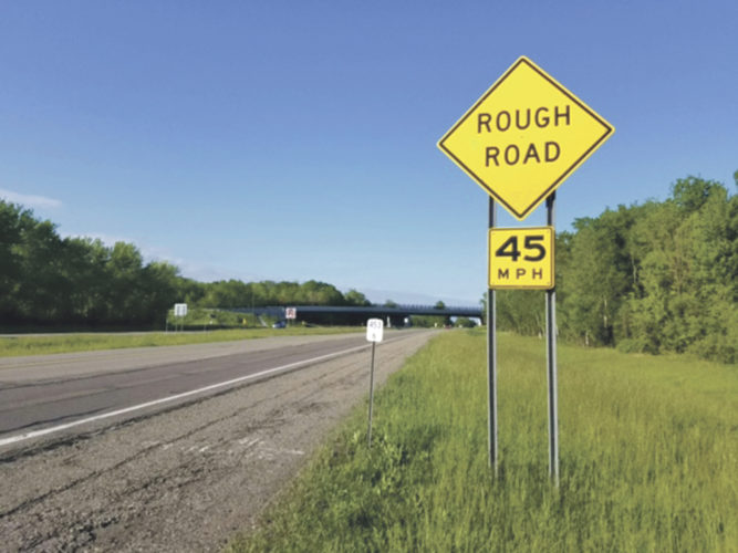 """OBSERVER Photo by Greg Fox The section of the Thruway that stretches through the Cattaraugus Indian Reservation has been in a state of disrepair for quite a while, as  evidenced by this """"rough road"""" sign."""