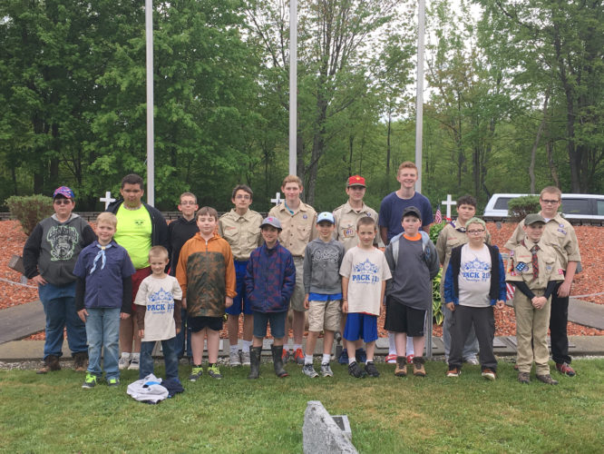 Submitted Photo Members of Cub Scout Pack 219 and Boy Scout Troop 219 placed flags on veterans graves in Cassadaga in honor of Memorial Day. The boys will be marching in Monday's Sinclairville and Cassadaga Memorial Day parades.