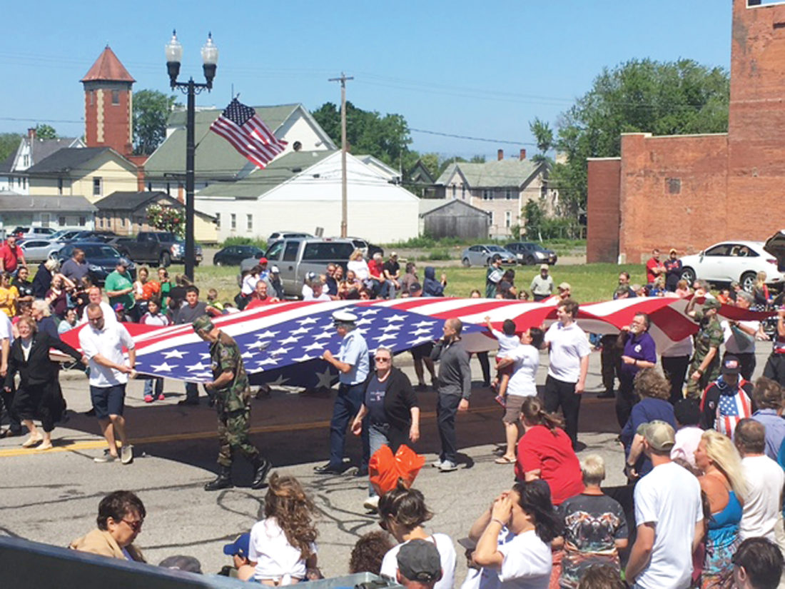 OBSERVER Photo Members of the Dunkirk Elks carry the U.S. flag at the start of the parade.