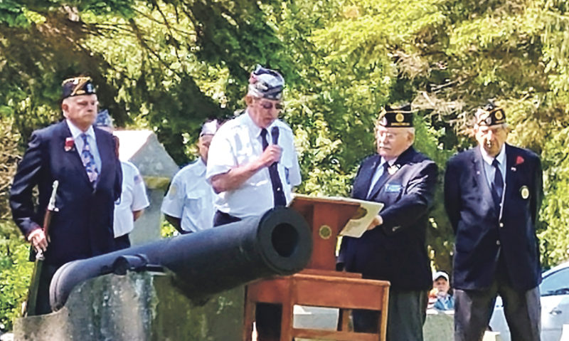 Photo by Ann Belcher Sons of The American Legion Squadron 434 Commander reads a touching piece titled The Final Inspection as part of the Memorial Day services held at Portland's Evergreen Cemetery.