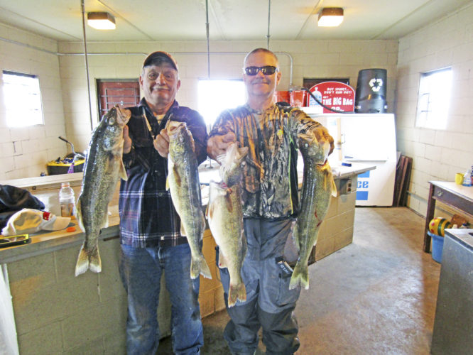 OBSERVER Photo by Gene Pauszek Paul Druyer, left, and Bud Marsh display a nice catch of Lake Erie Walleye caught during the daytime last Wednesday.